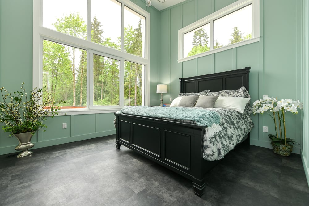 bedroom with large window and light green walls