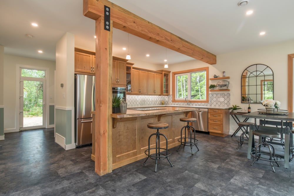 Kitchen with timber frame beam and island and tile floors