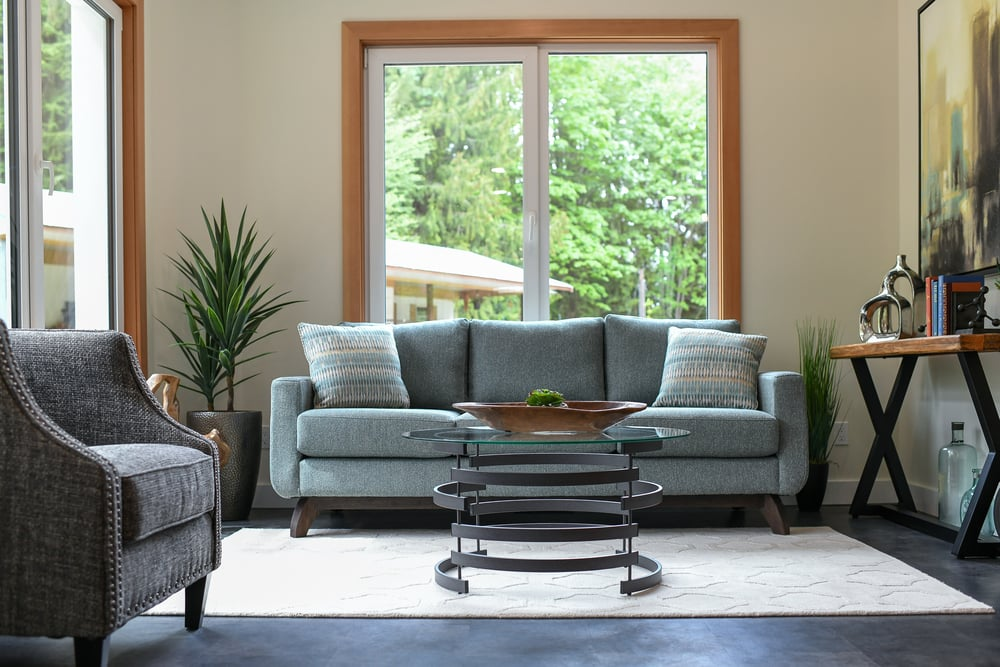 living room with blue couch and coffee table